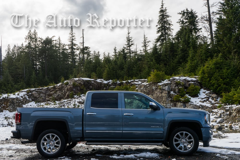 the 2016 gmc sierra denali 1500 takes on the mountains. Black Bedroom Furniture Sets. Home Design Ideas
